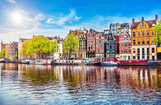 Amsterdam-Netherlands-dancing-houses-over-river-Amstel-landmark-min