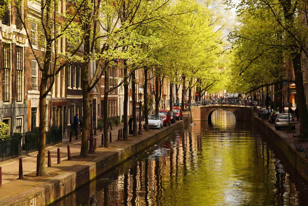 Amsterdam-with-green-canal-in-the-downtown-min