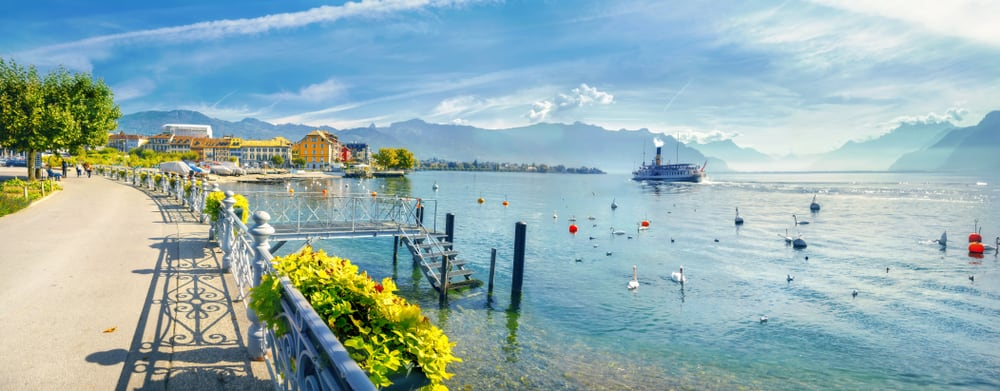 Panoramic view of Geneva Lake with beautiful embankment in Vevey town